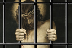 Jesus wearing crown of thorns holding prison bars inside a cell.
